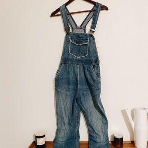 Vintage denim overalls with statement front pocket
